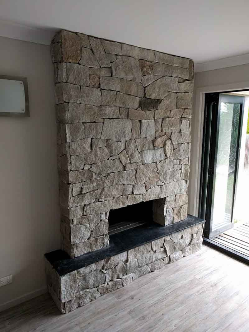 tall concrete fireplace
