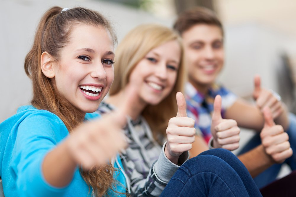 Young adults who see their dentist near Avon Lake, OH, regularly