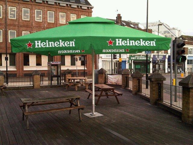 a heineken parasol outside a pub