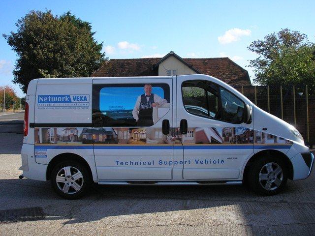 graphics on a white van