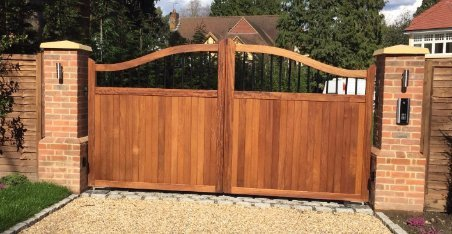 large curved wooden gate with metal spikes