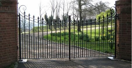 curved black metal gates