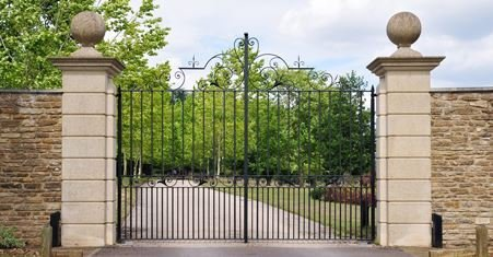 ornate metal gates with stone pillars