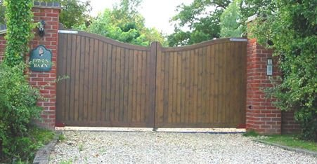 wooden board gate with dipped curve