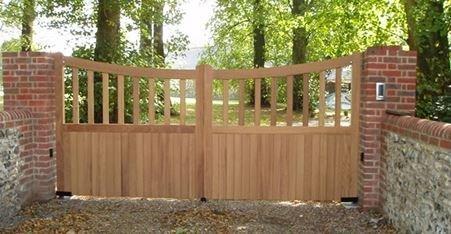 Wooden gate, half boarded, residential driveway gate, brick piers, GSM intercom, FAAC 770 underground motors, Portcullis Electric Gates LTD.