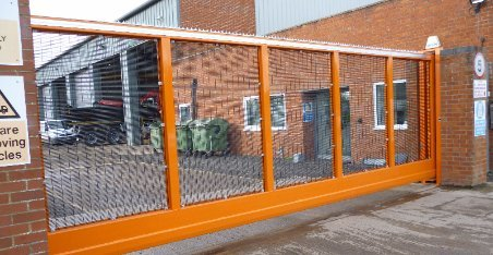 wide metal security gates in orange