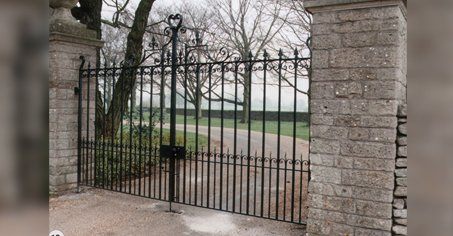 tall black electric gates