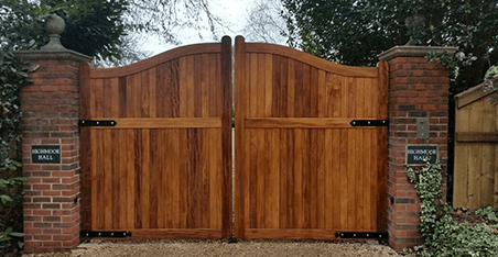 large wooden gates with metal brackets