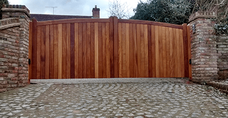 wooden board gate with shallow curve