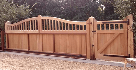 wide wooden vehicle and pedestrian gates