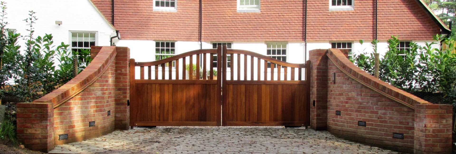 tall curved wooden gates with curved brickwork