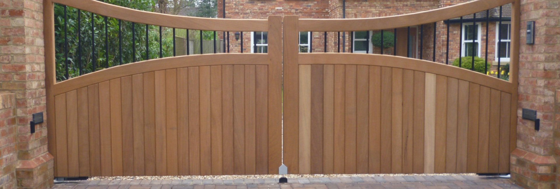 thick wood gate with dipped curve towards centre