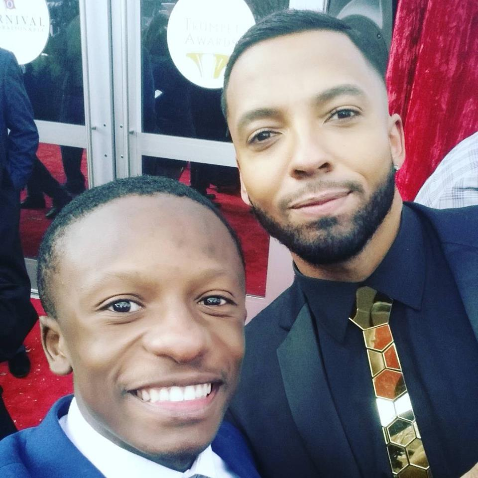 Rev. Jared Sawyer Jr. and Christian Keyes on the red carpet of the Trumpet Awards