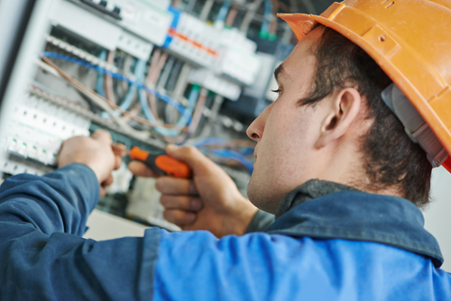 Electrical expert checking electrical and security system