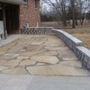Professional providing landscaping services in a yard in Centralia, MO