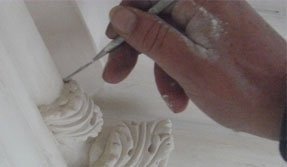 Hand applying touches to moulding