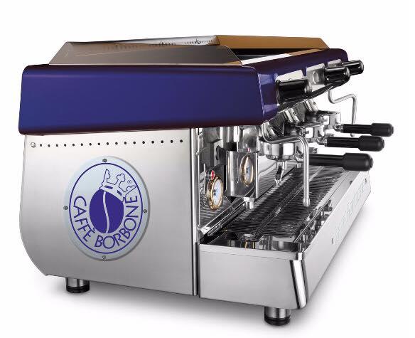 una macchina del caffe' in acciaio della marca Caffe' Borbone vista di lato