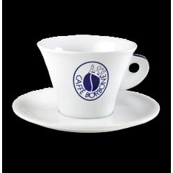 una tazza bianca con scritto Caffe' Borbone