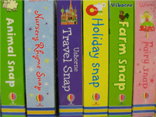 A row of brightly coloured children's books