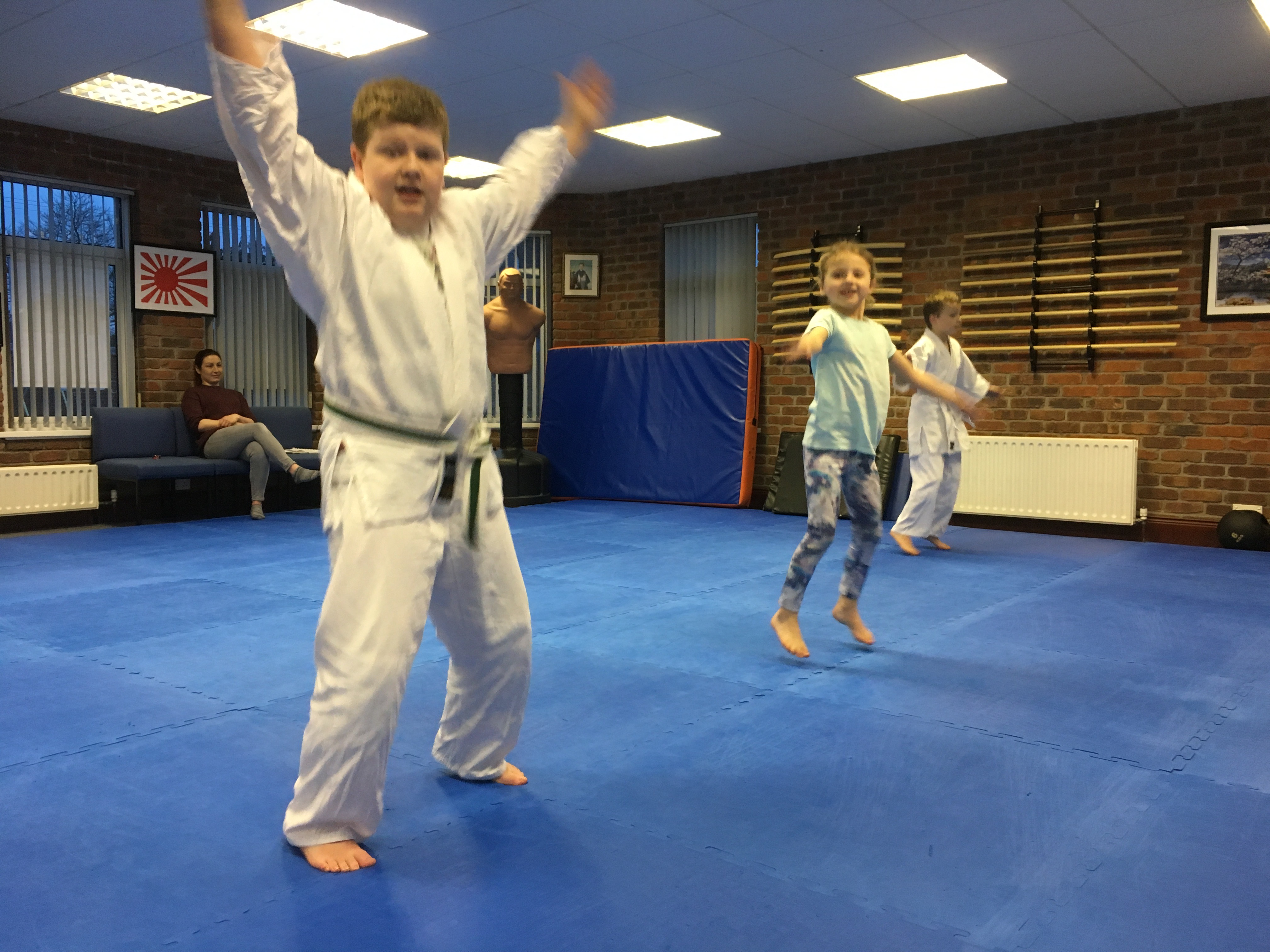 image of children warming up jumping at start of the lessonMartin Acton sensei in his dojo. Martin Acton's Aikido Institute