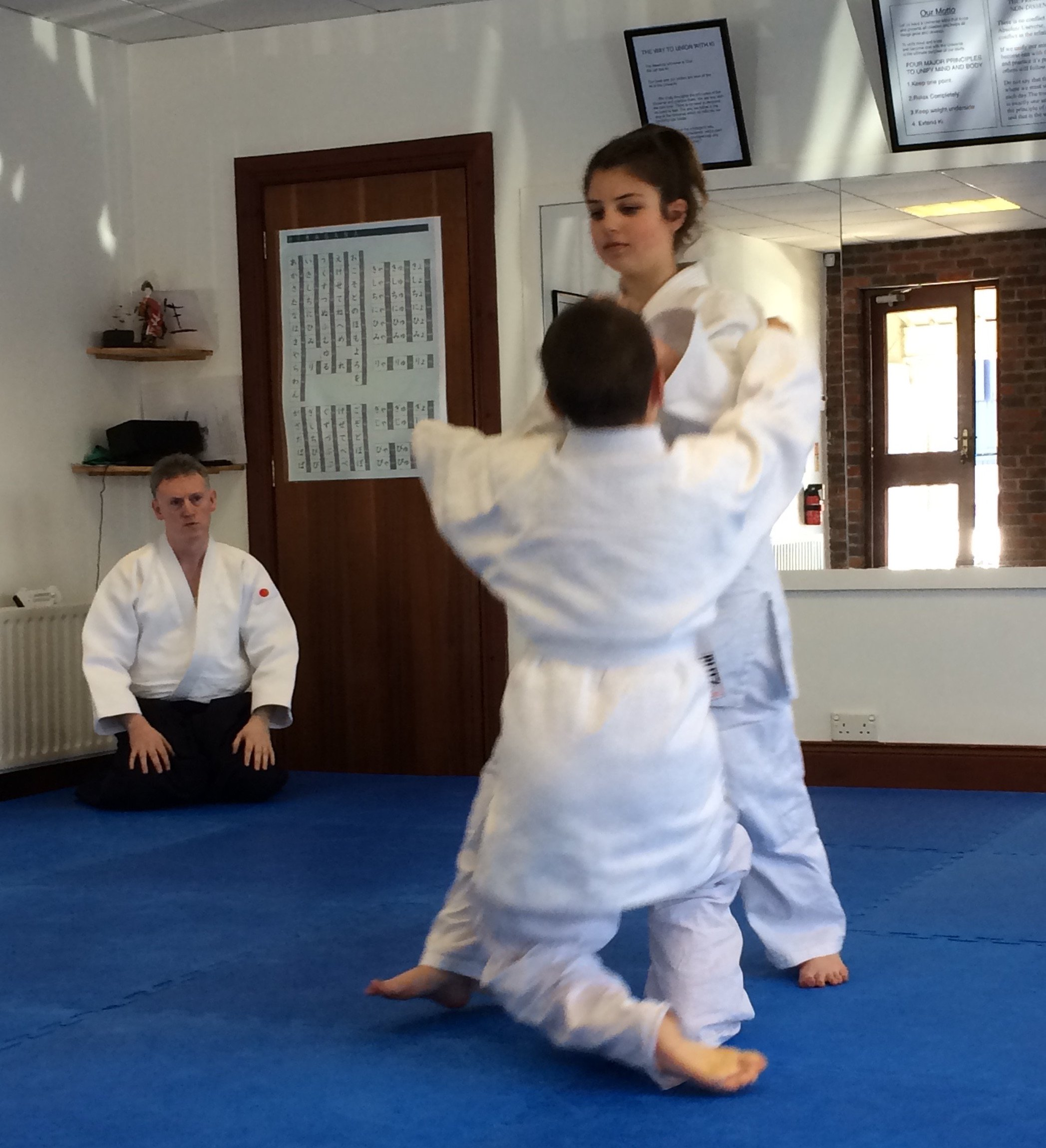 Girl and boy practicing Aikido