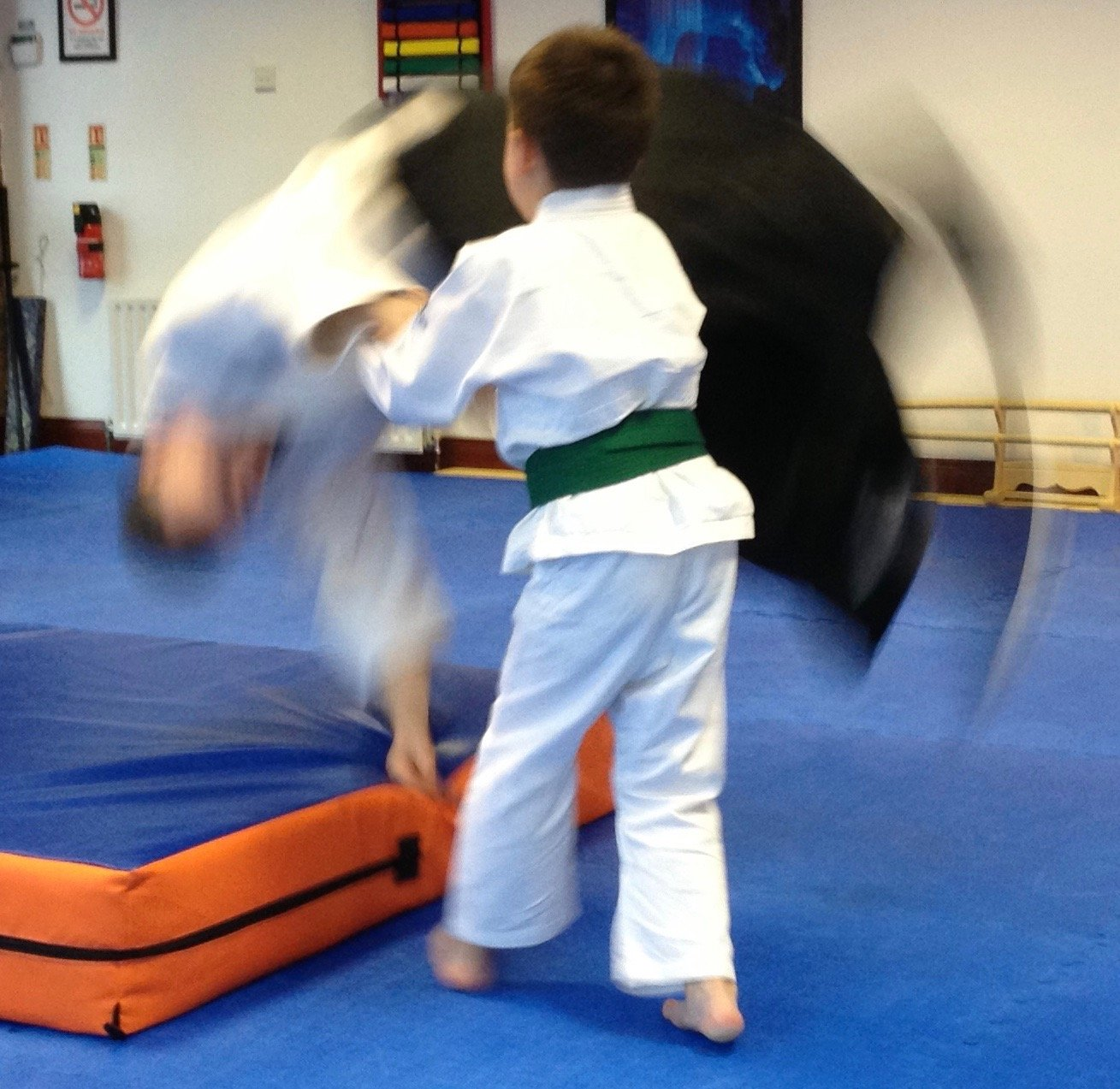 Aikido boy green belt throwing Martin sensei on a crash mat. Martin Acton's Aikido Institute