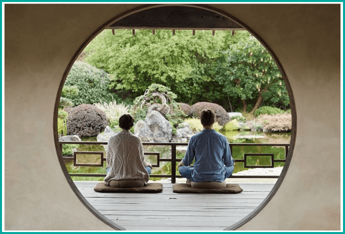 Couple meditating in Buddhist temple. Martin Acton's Aikido Institute