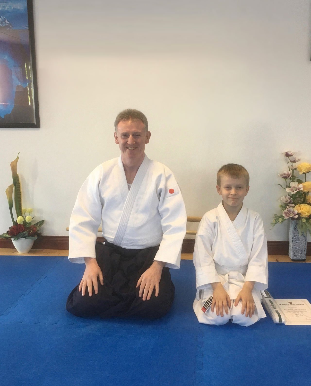 Matthew Smith receiving his certificate for passing his grade. Martin Acton's Aikido Institute