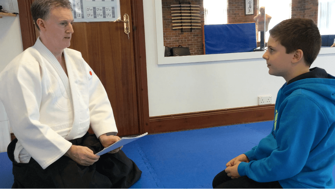 Japanese language courses. Young boy being testing on his Japanese languages skills. Martin Acton's Aikido Institute