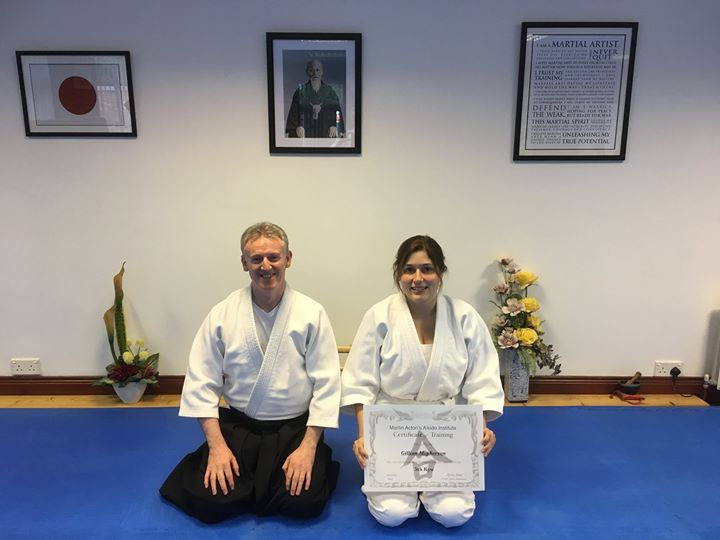 Gillian Mcpherson receiving her Aikido 5th kyu grading with Martin Acton sensei. This photo was taken on the 17th /8/2017 at Martin Acton's Aikido Institute