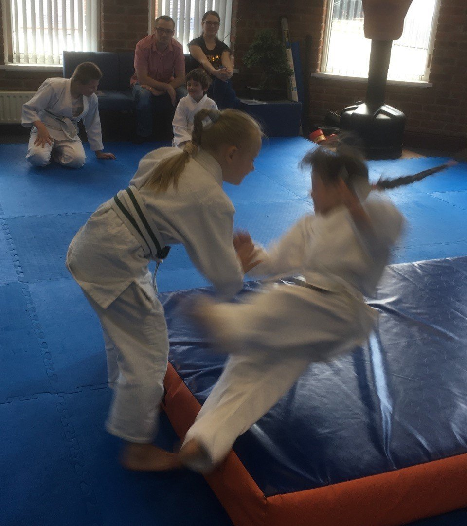 Aikido beginner lessons. Two girls learning to throw and fall safely. Martin Acton's Aikido Institute
