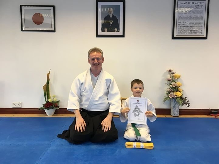 Eamon receiving his Aikido 9th kyung yellow belt with  Martin Acton sensei on the  6/9/2017 at Martin Acton's Aikido Institute