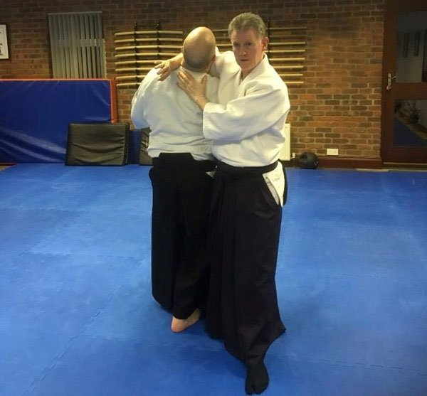 Martin Acton teaching Chris McGrath a technique for his next test. Martin Acton's Aikido Institute