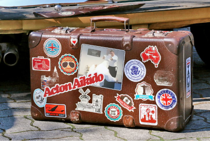 Old leather suitcase with lots of stickers