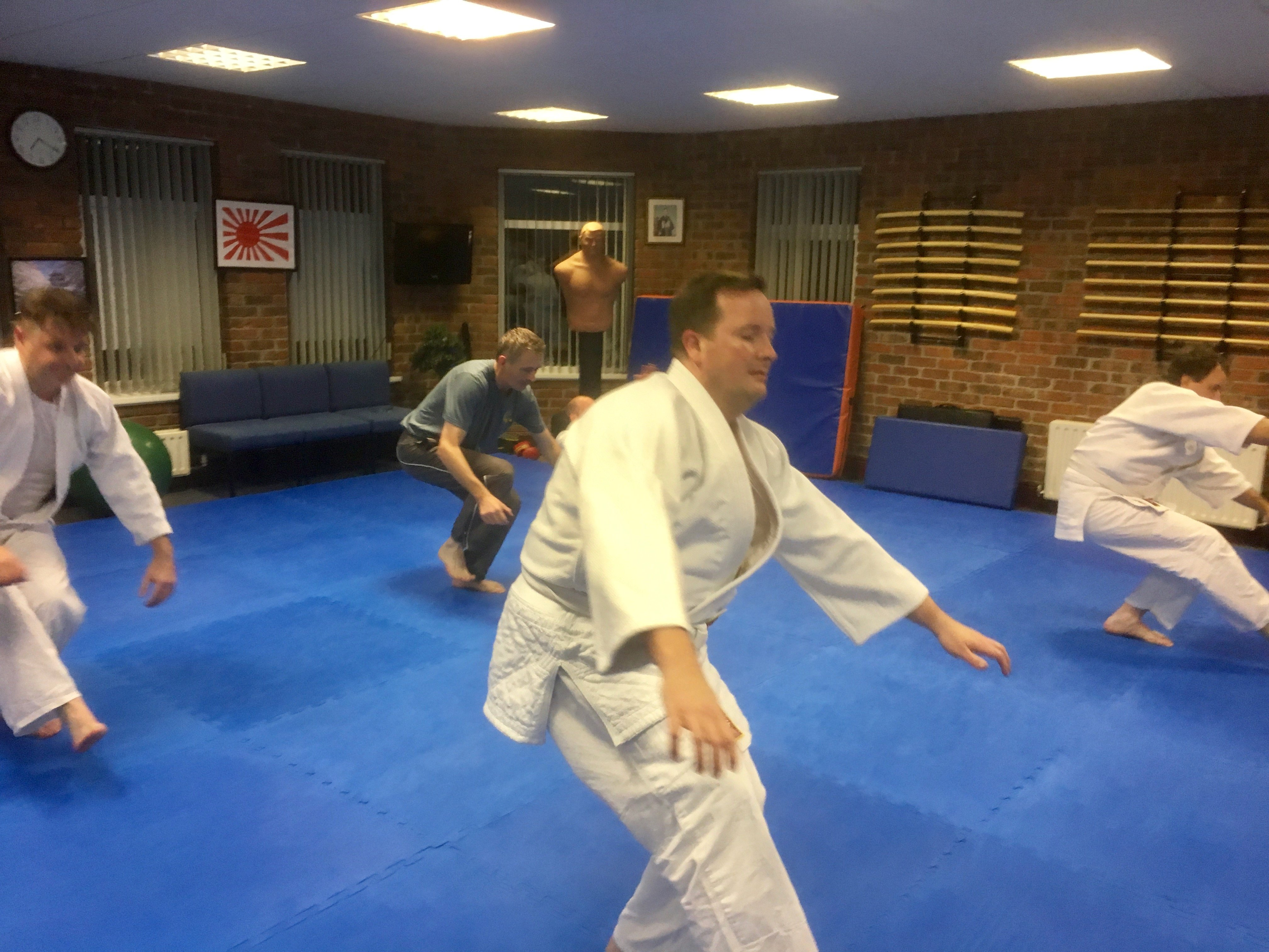 Adult aikido students warming up also falling safely. Martin Acton's Aikido Institute
