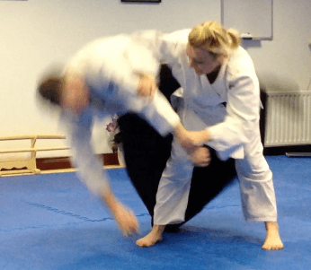 Aikido lady practicing a throw. Martin Acton's Aikido Institute