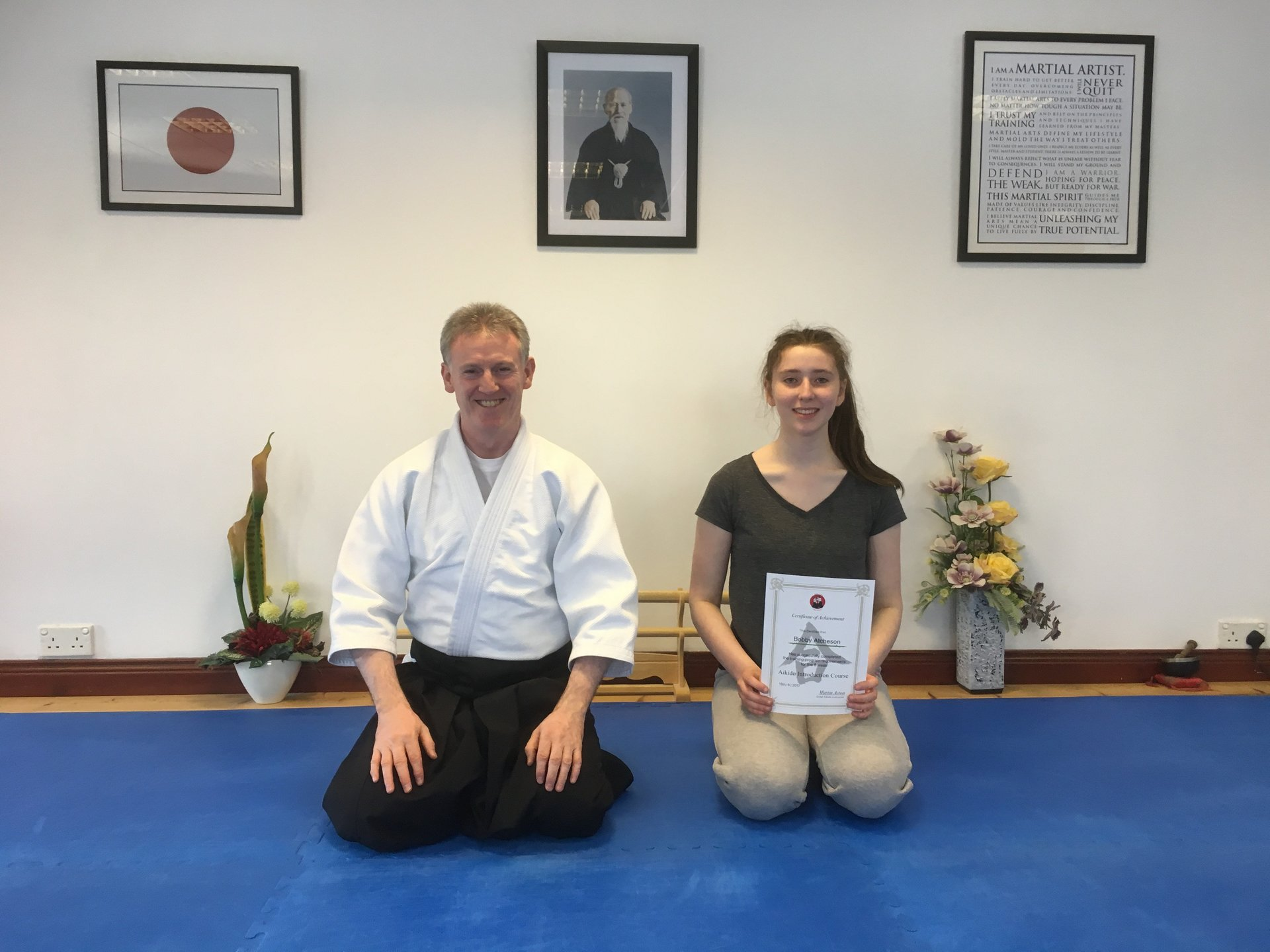 this is Bobby Atcheson receiving her Aikido 8-week Introduction Course  Certification with Martin Acton sensei on the 15/6/2017 at Martin Acton's Aikido Institute