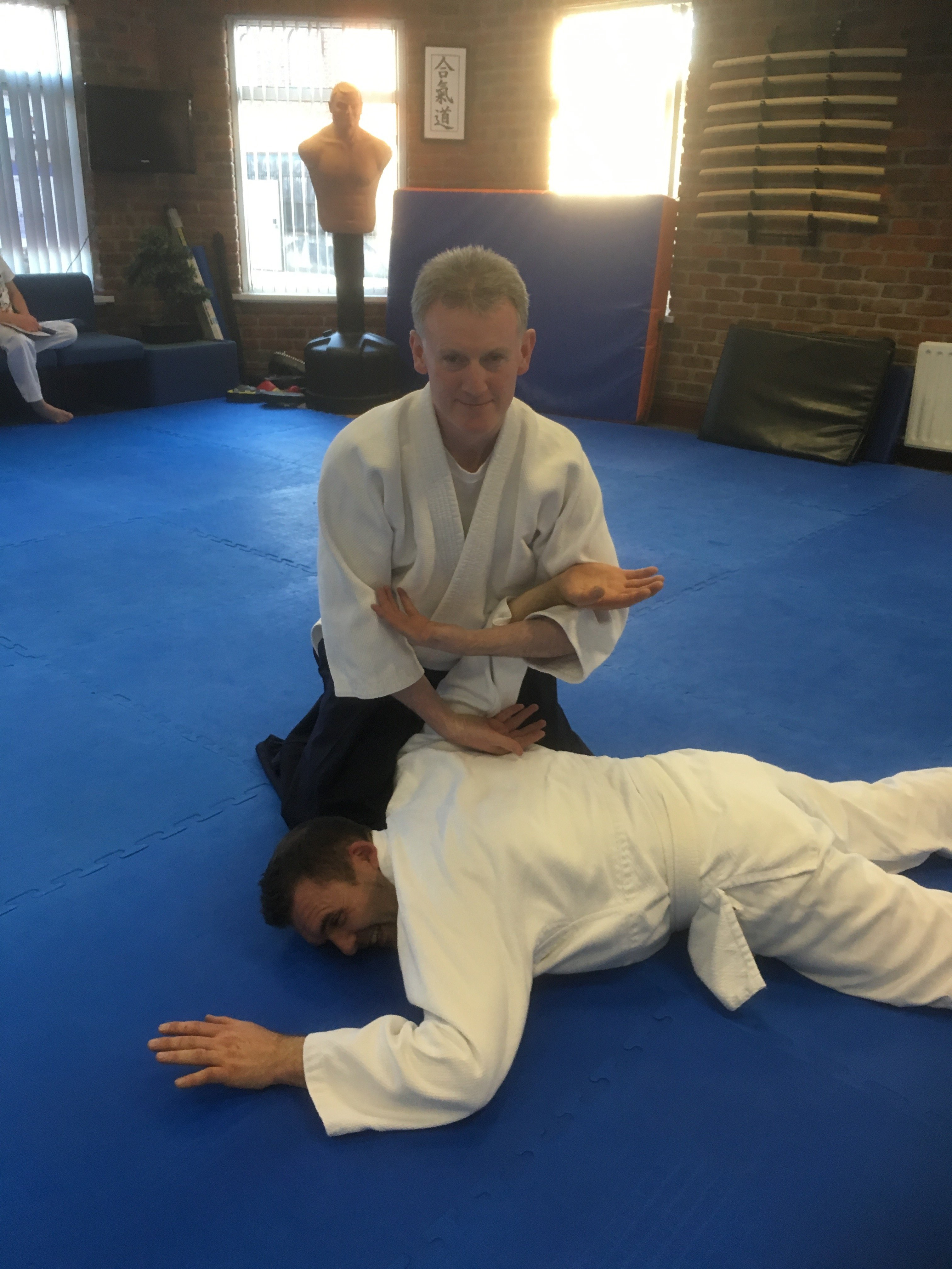 Two students, one in an armlock