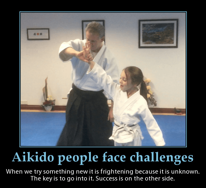Aikido child performing a throw with Martin Acton sensei. Martin Acton's Aikido Institute