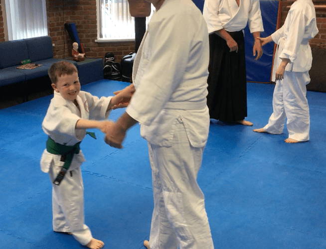 5-year-old practicing Aikido with adults at Martin Acton's Aikido Institute