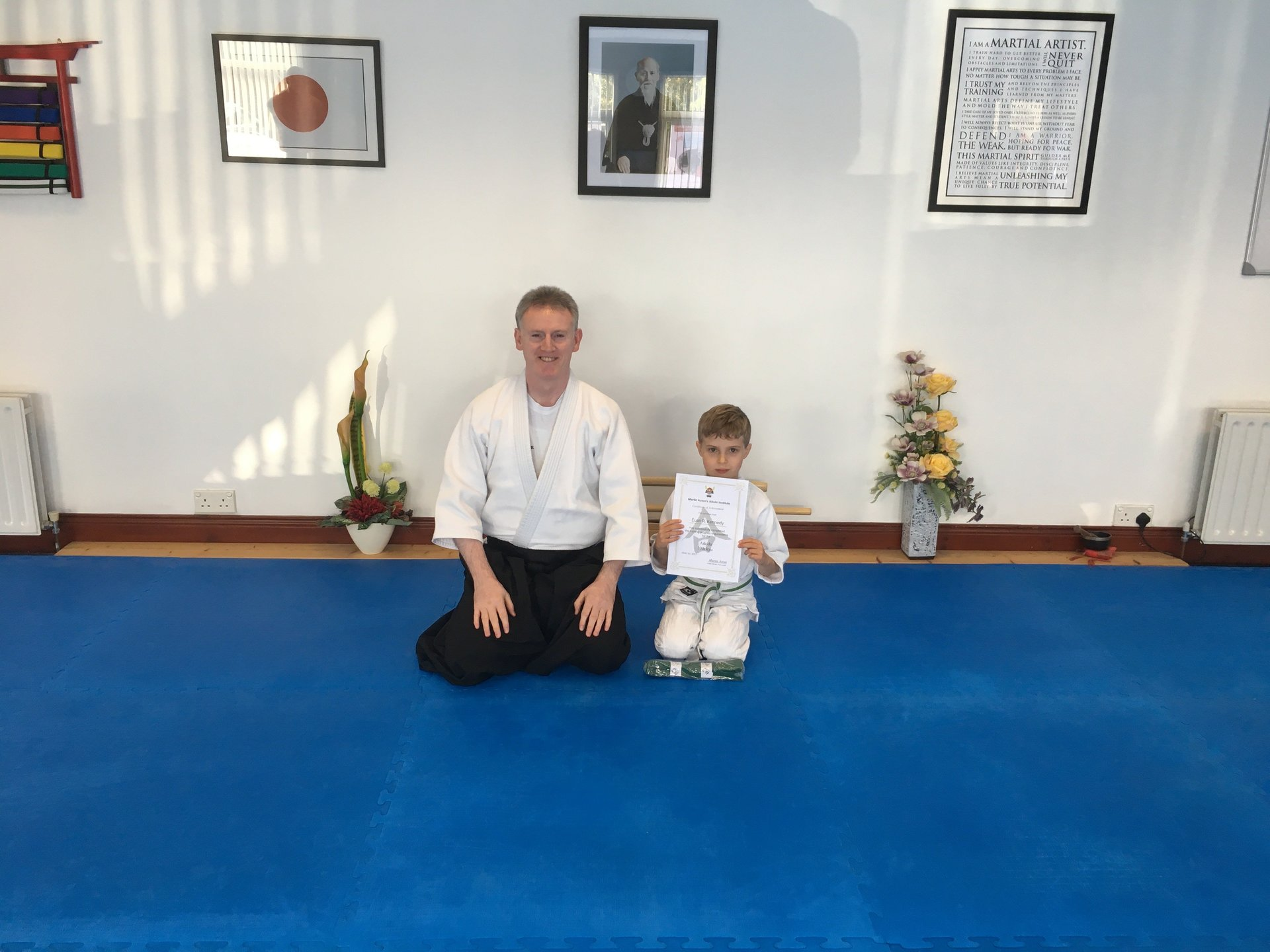 Euan R. Kennedy reaching his Aikido 10th kyu Green belt certification with Martin Acton sensei