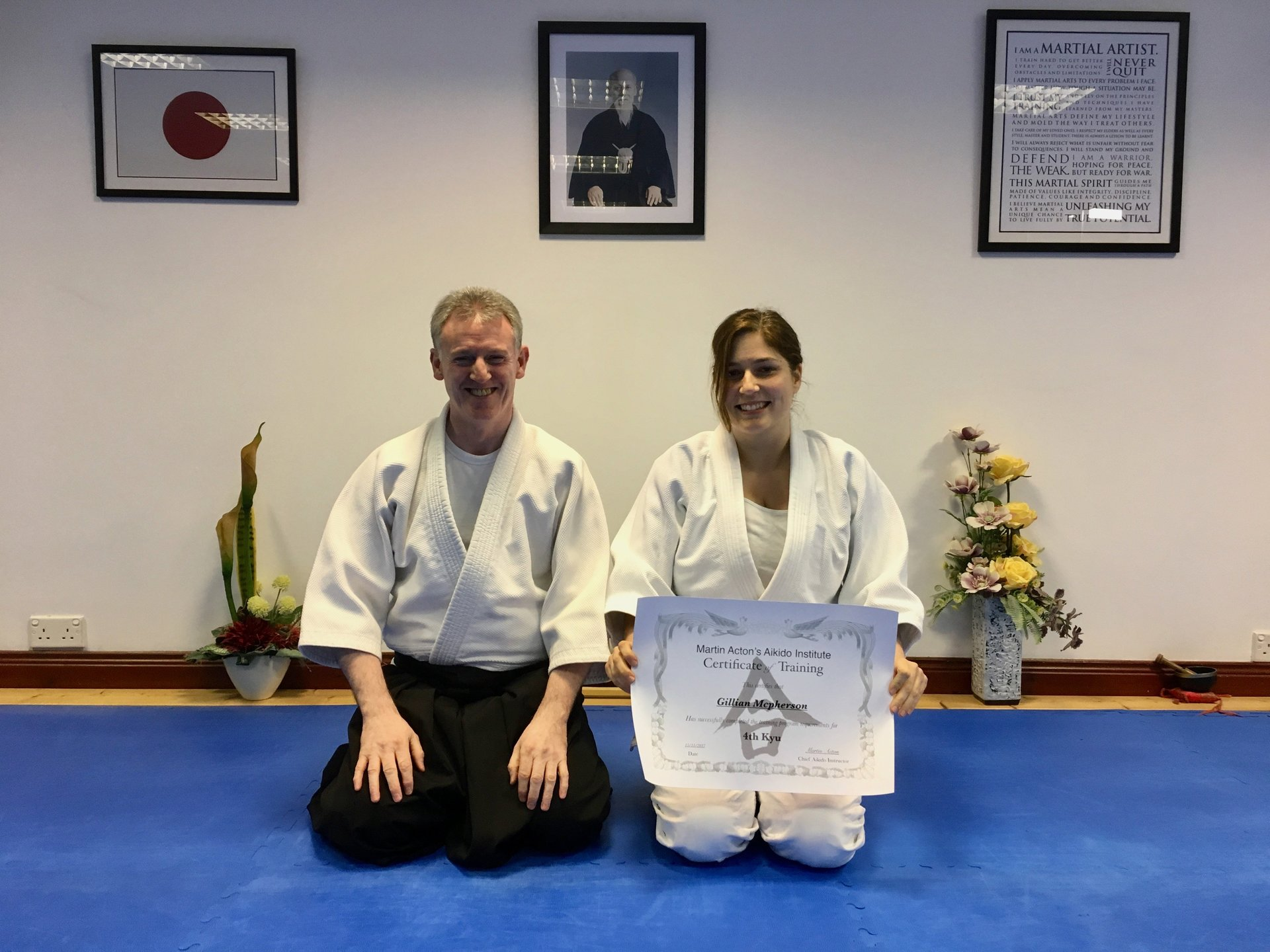 Gillian Mcpherson receiving he Aikido 4th kyu certicication with Martin Acton sensei.