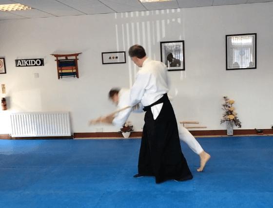 Martin Acton sensei throwing a student using the jo.