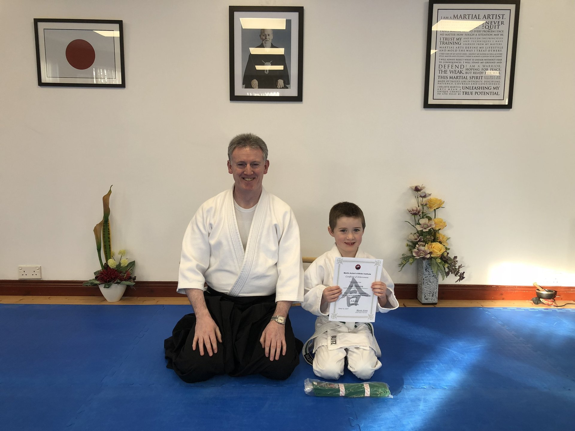 Joel Gilmore receiving his Aikido 10th kyu grading certification with Martin Acton Sensei on the 23/12/2017 at Martin Acton's Aikido Institute.