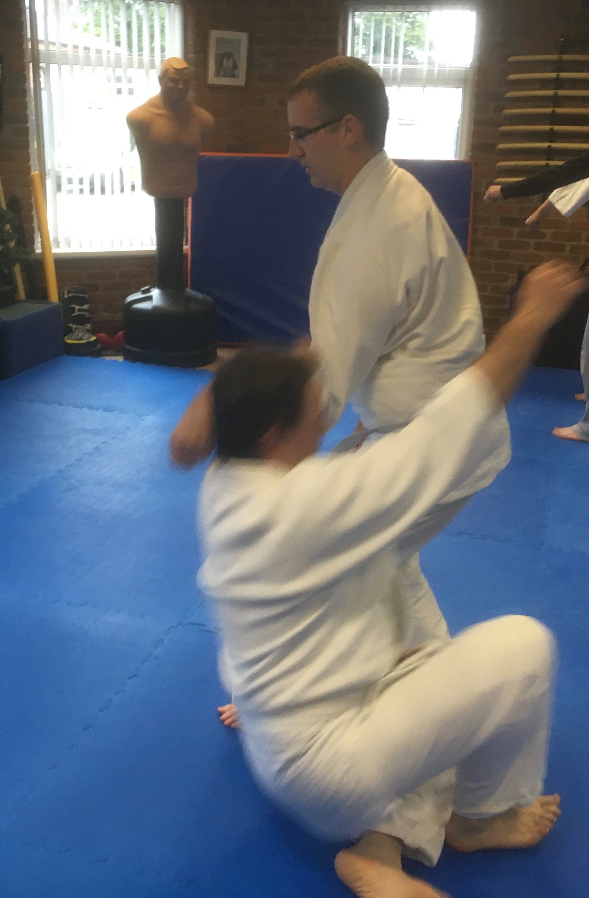 Two students practicing aikido