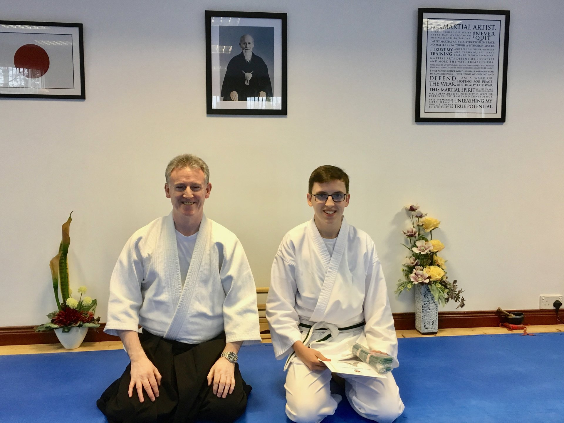 Joshua McGreevy receiving his certification for passing his Aikido 10th kyu green belt grading on 18/11/2017 at Martin Acton's Aikido Institute.