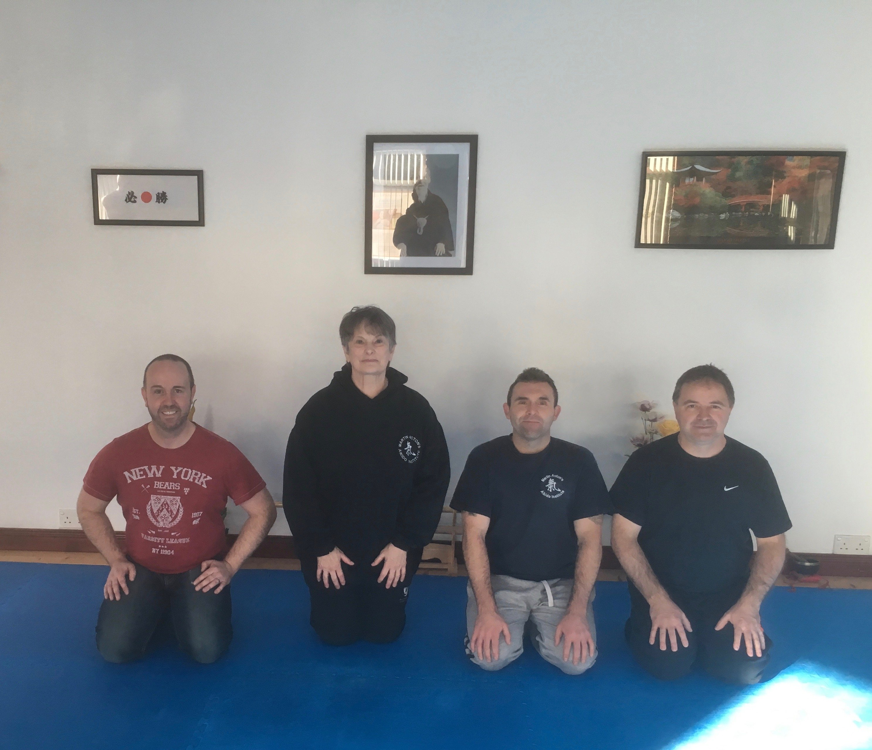 Four students kneeling down for Japanese Sword Seminar