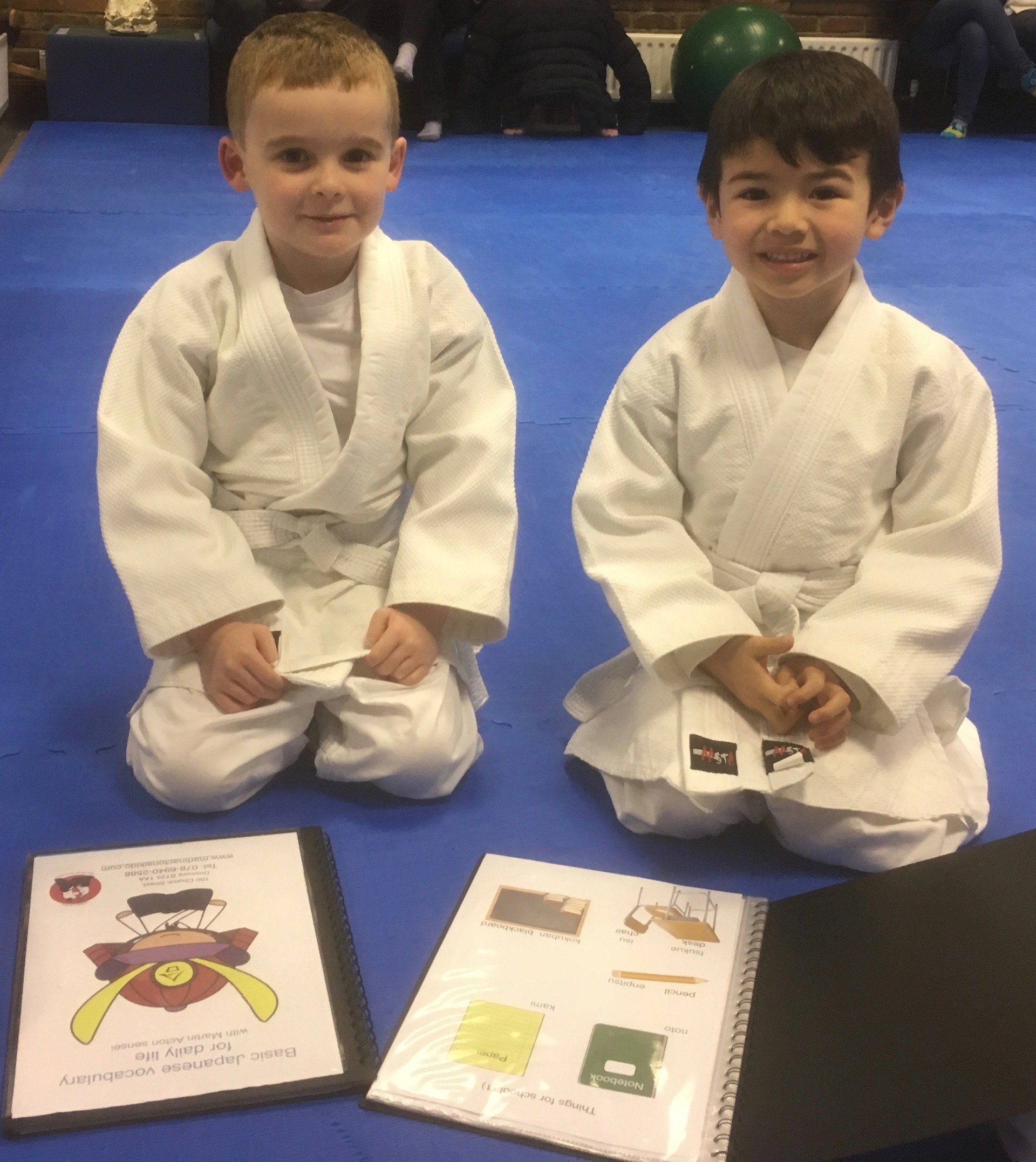 Two boys getting ready to practice Japanese in the children's Aikido class. Martin Acton's Aikido Institute