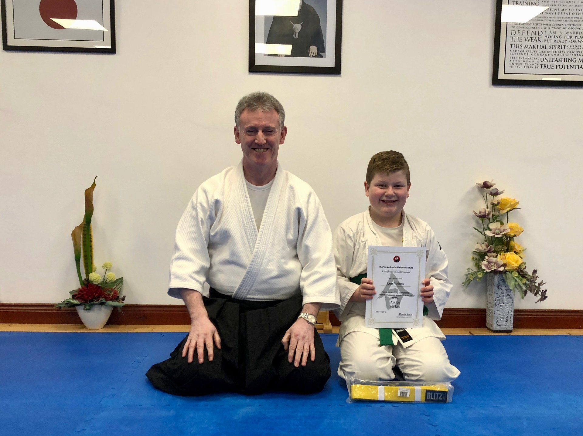 This is a photo of Lee Pollock receiving his Aikido 9th kyu yellow belt  certification with Martin Acton Sensei at Martin Acton's Aikido Institute on the 8th/1/2018