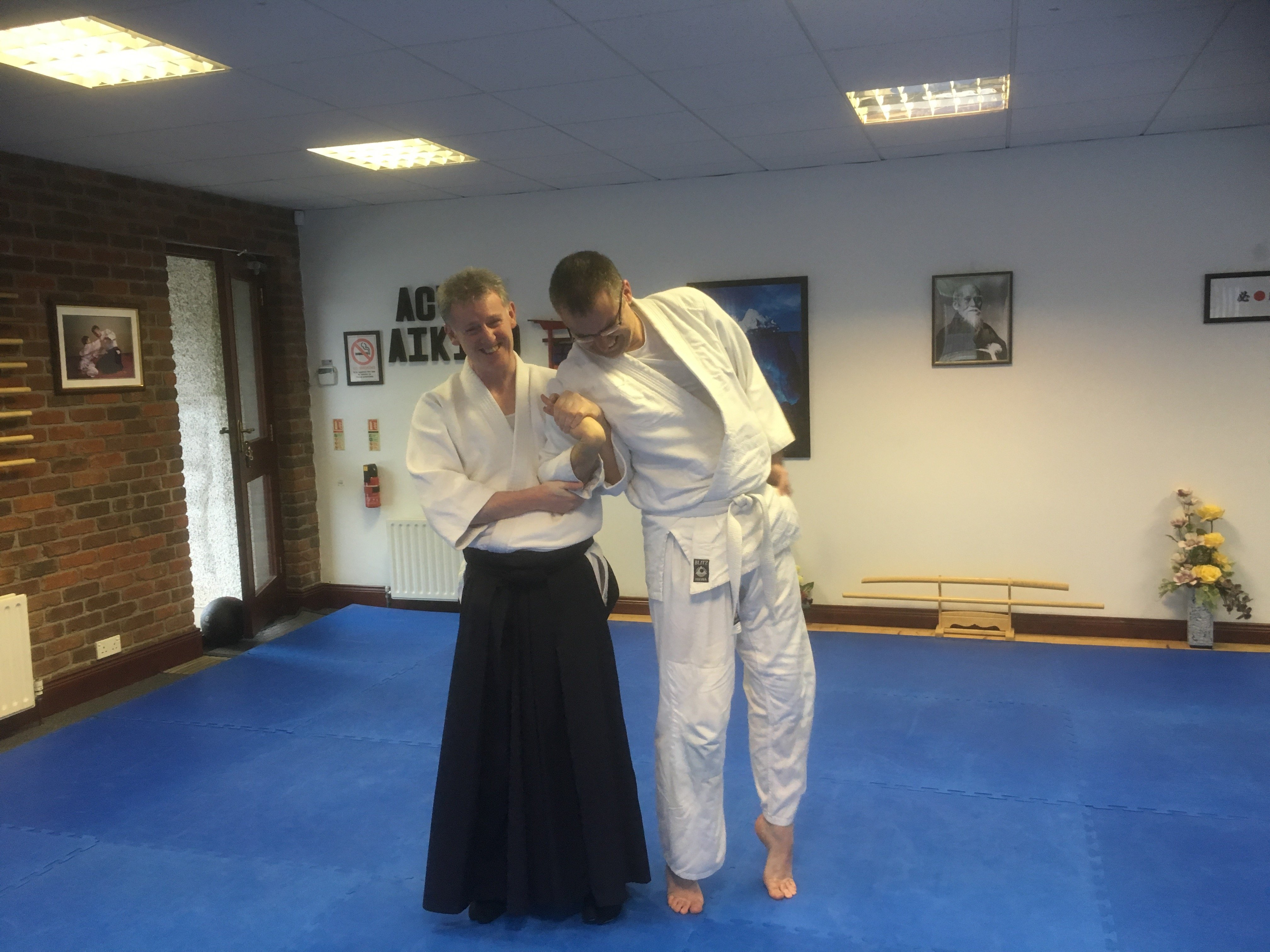 Martin and student practicing aikido